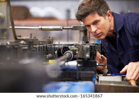 Factory Engineer Operating Hydraulic Tube Bender - stock photo