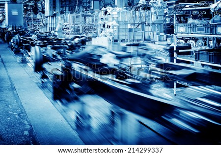 Factory floor, car production line, motion blur picture. - stock photo