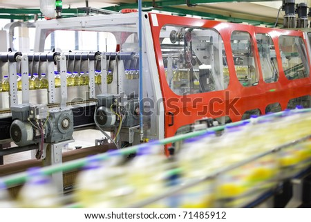Factory for the production of sunflower oil. Shallow DOFF. Selective focus. - stock photo