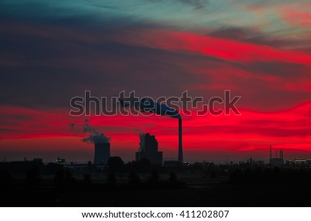 Factory pipe polluting air - stock photo