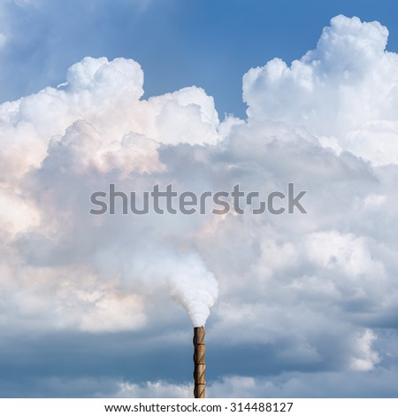 Factory pipe smoking with a white smoke over the sky - stock photo