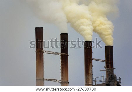Factory pipes fumes - stock photo
