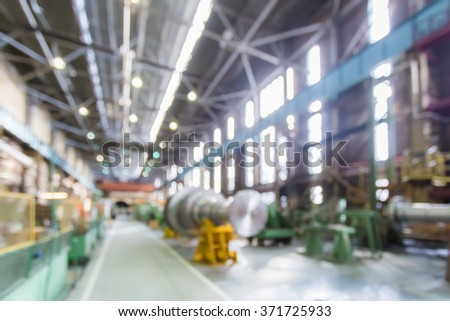 Factory shop in bokeh, defocused background - stock photo