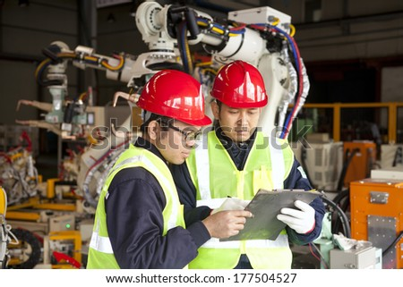 Factory team work on discussing - stock photo