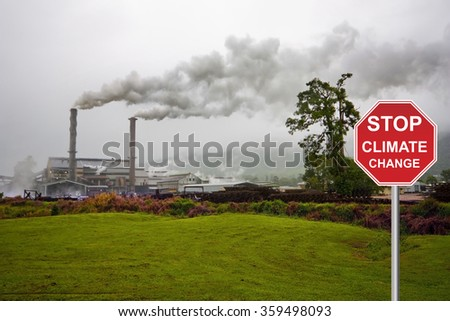 factory with smog and stop sign - stock photo