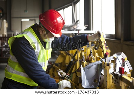 Factory worker on working - stock photo
