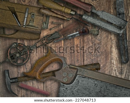faded colors of a vintage woodworking tools on wooden bench, space for your text - stock photo