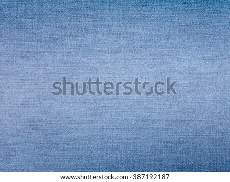 Faded light blue jeans denim fabric background - stock photo