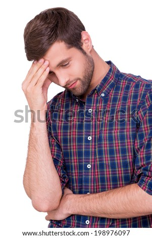 Failed again. Frustrated young man in casual shirt touching his forehead with hand and keeping eyes closed while standing isolated on white - stock photo