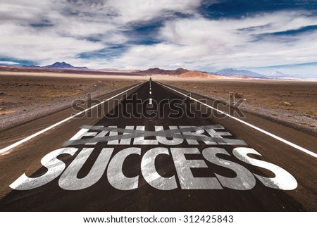 Failure Success written on desert road - stock photo