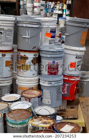 FAIRFAX, VA - DECEMBER 5: Paint cans stacked in a container to be brought to a recycling facility on December 5, 2013 in Fairfax, VA. The metal will be sorted, melted and recycled. - stock photo