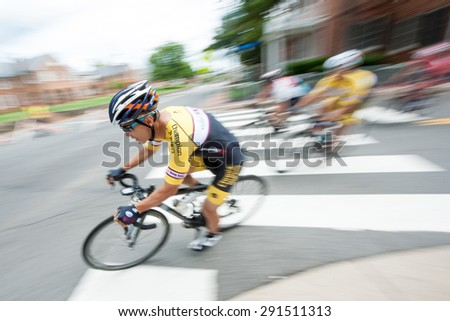 FAIRFAX, VA - JUNE 28: A member of the Hong Kong police team competes in the criterium at the World Police & Fire Games on June 28, 2015 - stock photo