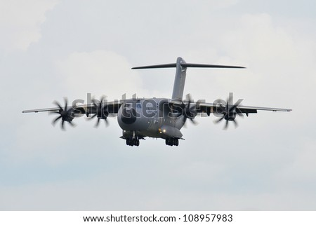 FAIRFORD, UK - JULY 8: Airbus A400 Transport aircraft participates in the Royal International Air Tattoo airshow event July 8, 2009 near Cirencester, England. - stock photo