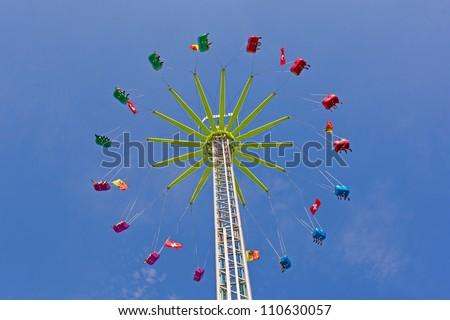 Fairground Carousel against a blue sky background - stock photo