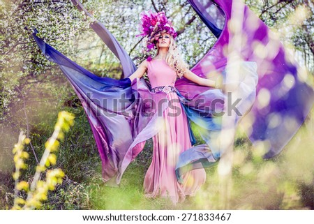 Fairies are real, beautiful Woman wearing a flower crown symbolizing spring - all images in this series shot with an open aperture - very shallow depth of field - stock photo