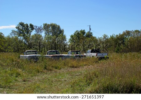 FAIRLAND, OK - OCTOBER 09: Old Used Trucks Parked in Rural Vacant Lot 2013 - stock photo