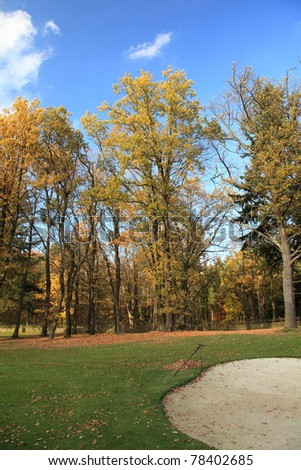 fairway with a bunker of autumn golf course - stock photo