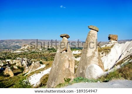 Fairy chimneys at Cappadocia, Turkey (The three beauties at Urgup) Travel / Cappadocia / Tourism / Turkey Background - stock photo