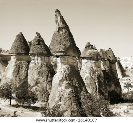 Fairy chimneys (rock formations) near Goreme, Cappadocia, Turkey. Monochrome sepia toned version - stock photo