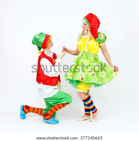 Fairy dwarf girl and her elf friend on white - stock photo