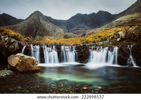 Fairy Falls, Isle of Skye, Scottish Nature. Autumn in Scotland.Turquoise water, scottish hills - stock photo