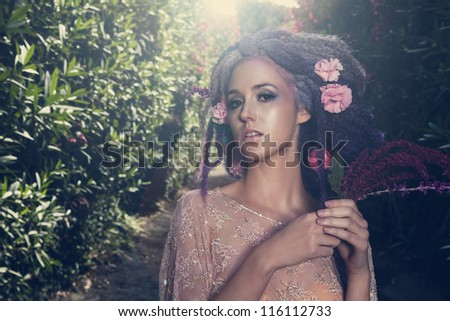 Fairy in flowers - stock photo