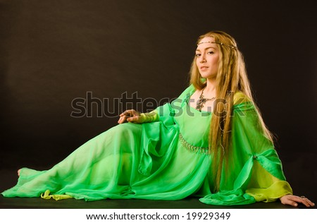 Fairy Lady in green dress - stock photo