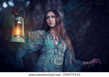 Fairy Portrait of girl. Fantasy fairytale beautiful woman. Mysterious Forest Nymph.Girl with a kerosene lamp. - stock photo