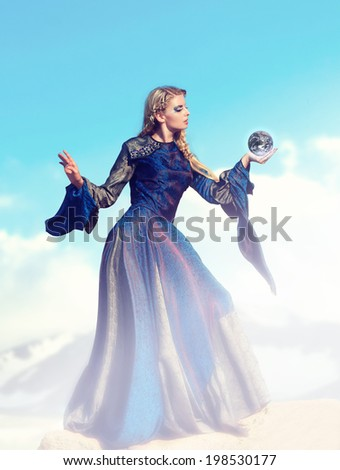 Fairy-tale � the sorceress with magic sphere - stock photo