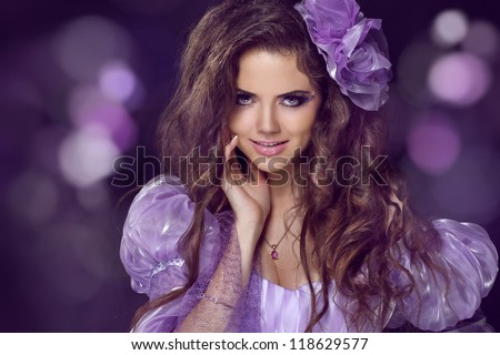 Fairy. Woman with beauty long brown hair. Jewelry and Beauty. Fashion photo studio - stock photo