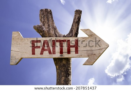 Faith wooden sign on a beautiful day - stock photo