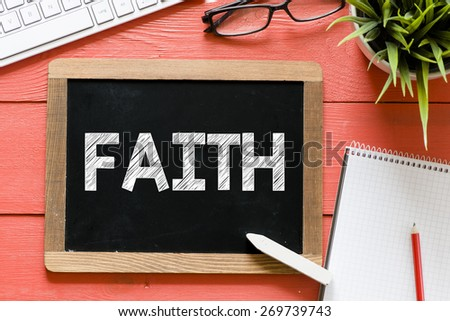 Faith word Handwritten on blackboard. Faith word Handwritten with chalk on blackboard, keyboard,notebook,glasses and green plant on wooden background - stock photo