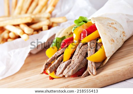 Fajitas with fries - stock photo