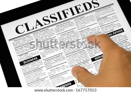 Fake Classified Ad, newspaper and Touch Screen, business concept. - stock photo