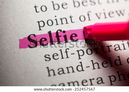 Fake Dictionary, definition of the word selfie. - stock photo