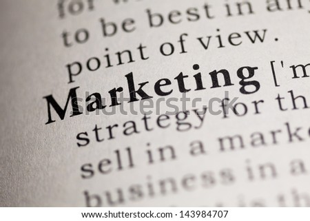 Fake Dictionary, Dictionary definition of the word Marketing. - stock photo