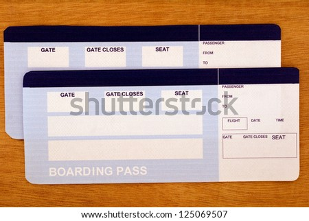 Fake flight tickets with empty spaces for your text on the table. Ready to go? - stock photo