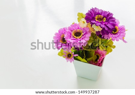 Fake flower in the vase - stock photo