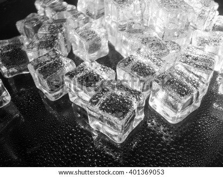 fake ice cubes sprayed with water black and white abstract concept - stock photo
