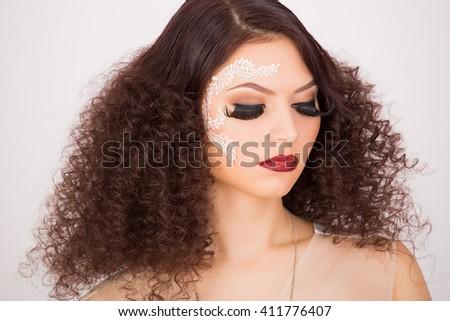 Fake long eyelashes and afro hairstyle, portrait shot  - stock photo
