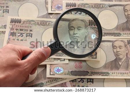 fake note? investigating Bills - stock photo