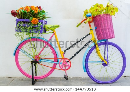 Fake plastic flower in vase on bicycle - stock photo