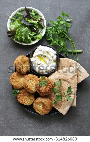 Falafel balls with yogurt dip and lettuce.Top view - stock photo