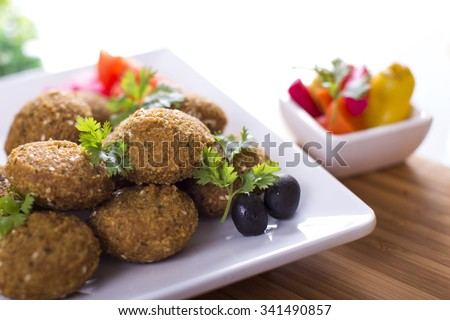 Falafel is a traditional Middle Eastern deep-fried ball or patty made from ground chickpeas, fava beans - stock photo