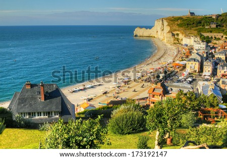 Falaise d`Amount and village d'Etretat - commune in the Seine-Maritime department in the Haute-Normandie region in northwestern France. Etretat is now a famous French seaside resort. - stock photo