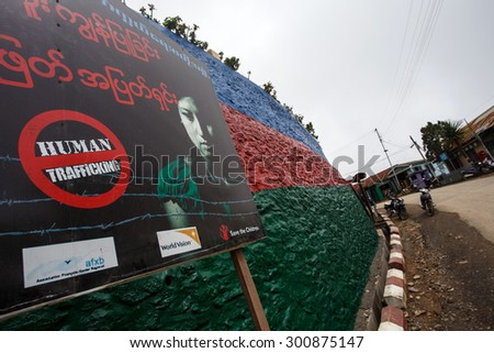 FALAM, MYANMAR - JUNE 18 2015: Human Trafficking sign in Falam Town in the recently opened to foreigners area of Chin State - western Myanmar (Burma) - stock photo