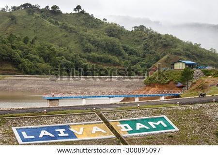 FALAM, MYANMAR - JUNE 17 2015: Laiva dam runs in Chin State at beginning of monsoon season in Western Myanmar (Burma) - stock photo