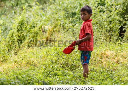 FALAM, MYANMAR - JUNE 17 2015: Local boy in the recently opened to foreigners area of Chin State - western Myanmar (Burma) - stock photo
