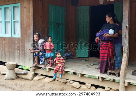 FALAM, MYANMAR - JUNE 17 2015: Local family in the recently opened to foreigners area of Chin State - western Myanmar (Burma) - stock photo