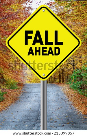 Fall ahead cautionary road sign against a fall background - stock photo